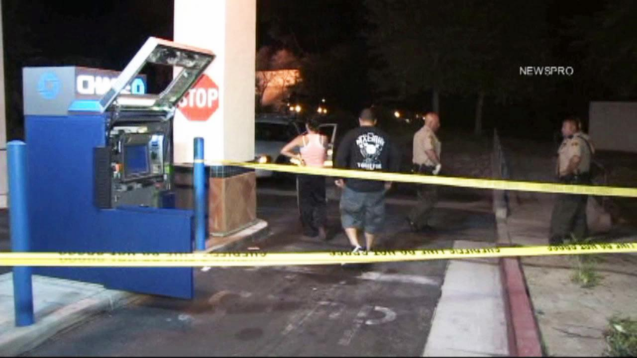Early Thursday morning someone saw two men using a blowtorch to cut out an ATM from a Chase Bank branch on Boulder Avenue and called authorities, according to the San Bernardino County Sheriffs Dept.