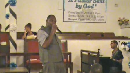 Anthony Lavon Smith is shown giving a sermon in this still image from a YouTube.com clip.