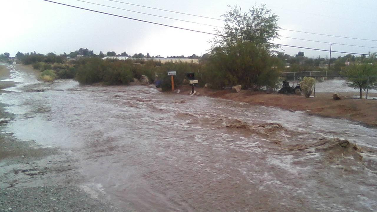 A flooded street is seen in Apple Valley in this photo sent by ABC7 viewer Tanya Gomez on Friday, Aug. 17, 2012.
