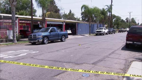 Masked men open fire in IE tire store; 2 dead
