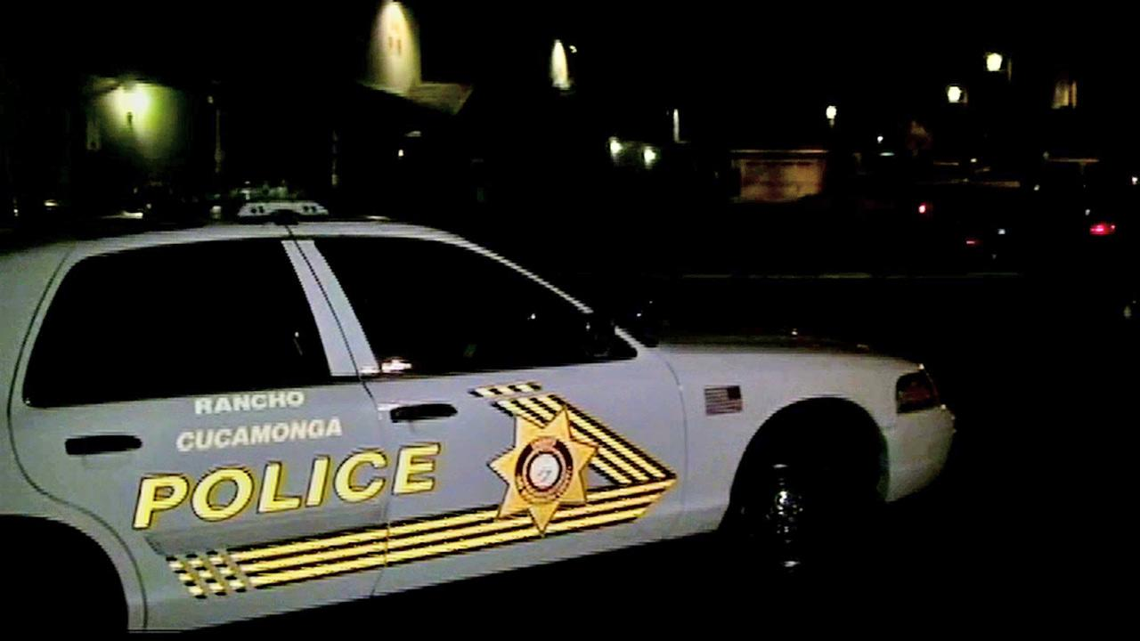 A Rancho Cucamonga police vehicle is parked outside the scene of a fatal stabbing on Tuesday, Nov. 20, 2012.