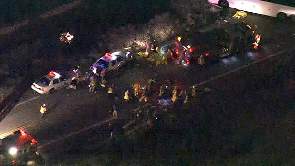 Rescue crews work at the scene of a deadly bus crash on State Route 38 north of Yucaipa o