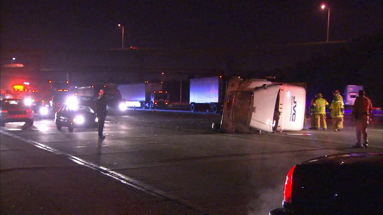 A big rig rolled over on its side on the eastbound 10 Freeway at the 215 Freeway Tuesday, Feb. 5, 2013.