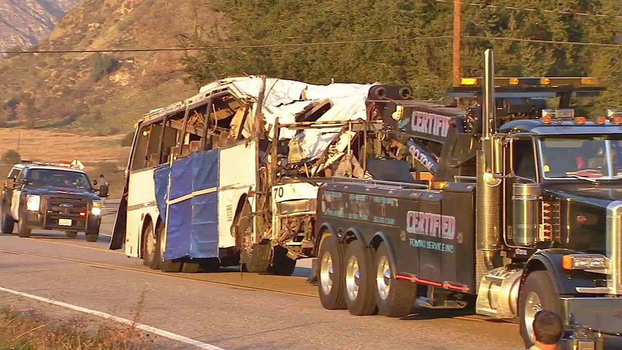 A tour bus involved in a fatal accident outside Yucaipa is seen being towed away on Monday, Feb. 4, 2013.