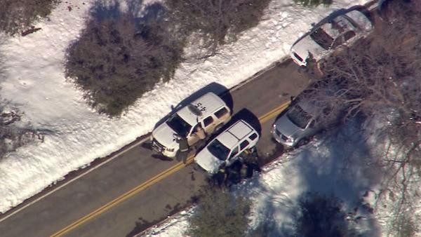 Authorities are seen in the Big Bear area on Tuesday, Feb. 12, 2013, following a possible Chris Dorner sighting.