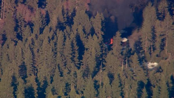 Smoke rises from a burning cabin in the Big Bear area where fugitive murder suspect Chris Dorner was believed to be holed up on Tuesday, Feb. 12, 2013.