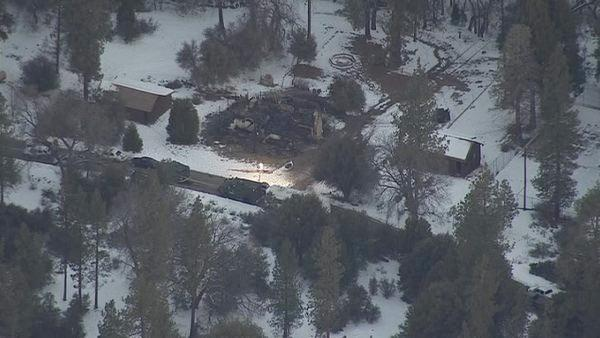 The rubble of a burned cabin in Angelus Oaks is sho