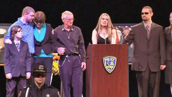 Wife Regina Crain speaks at a funeral service at Grove Community Church in Riverside for Officer Michael Crain on Wednesday, Feb. 13, 2013.