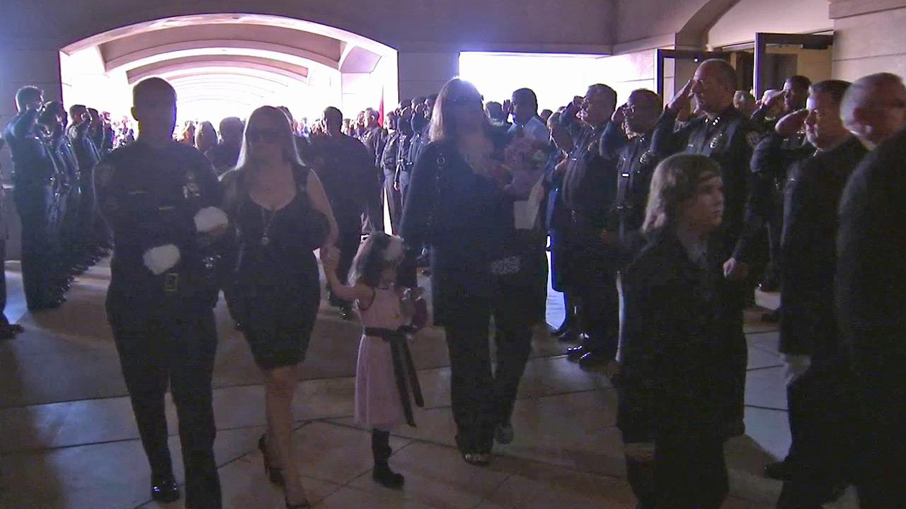 The family of Officer Michael Crain arrives at the funeral service at Grove Community Church in Riverside on Wednesday, Feb. 13, 2013.