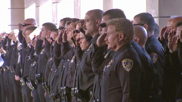 Hundreds of uniformed law enforcement officers gathered for a funeral service at Grove Community Church in Riverside for Officer Michael Crain on Wednesday, Feb. 13, 2013.