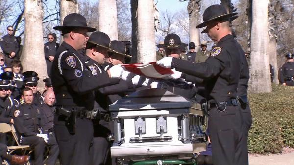Riverside Officer Michael Crain is laid to rest at Riverside National Cemetery on Wednesday, Feb. 13, 2013.