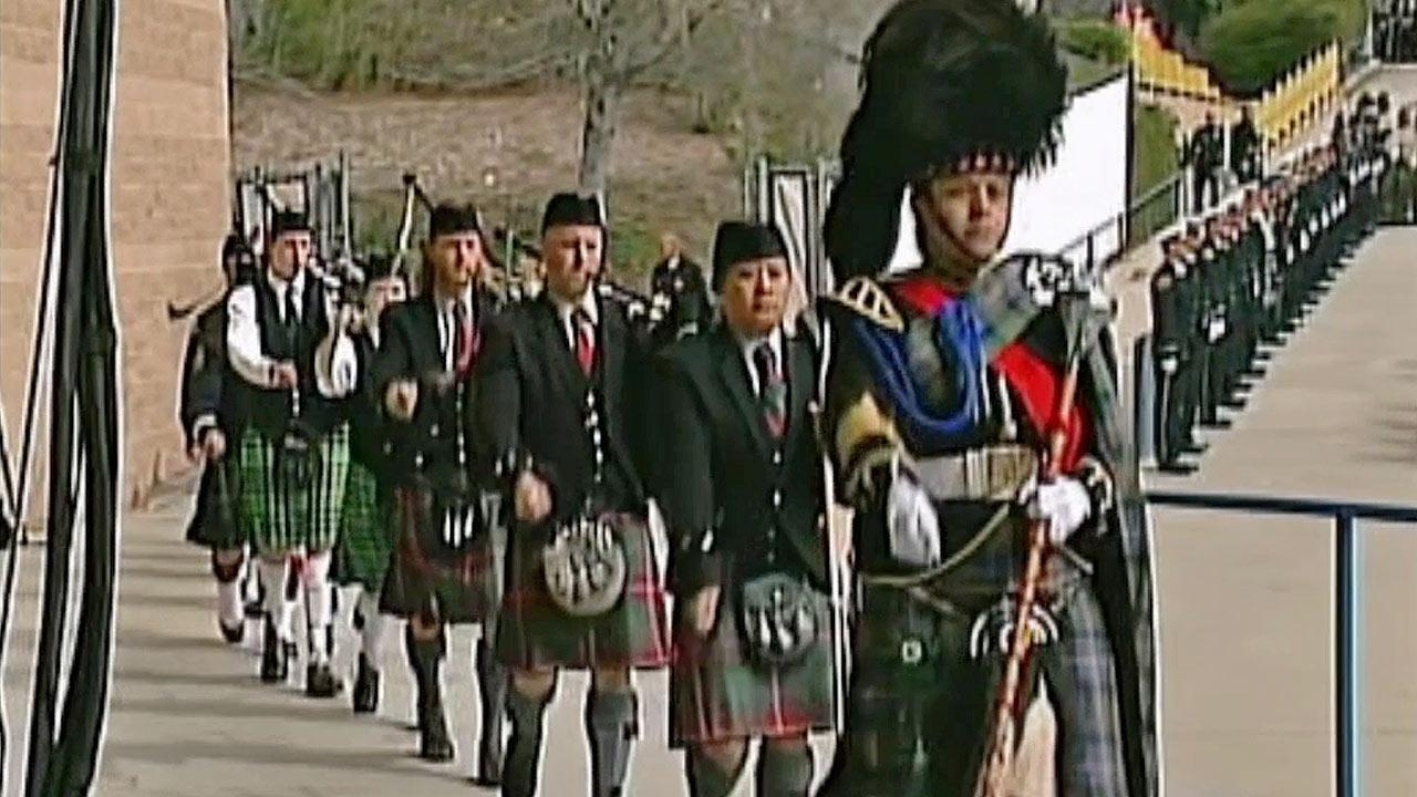 Bagpipers play at the start of the funeral for San Bernardino County Sheriffs Detective Jeremiah MacKay at the San Manuel Amphitheater in San Bernardino on Thursday, Feb. 21, 2013.