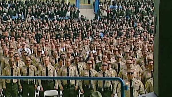 Thousands of law enforcement officers attend the funeral for San Bernardino County Sheriff's Detective Jeremiah MacKay at the San Manuel Amphitheater in San Bernardino on Thursday, Feb. 21, 2013.