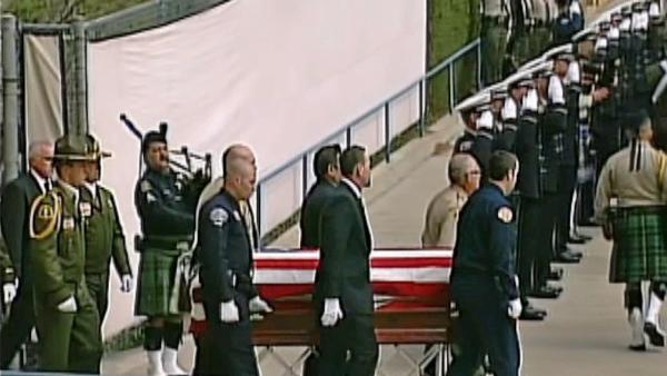 The flag-draped coffin of San Bernardino County Sheriff's Detective Jeremiah MacKay is seen at his funeral service on Thursday, Feb. 21, 2013.