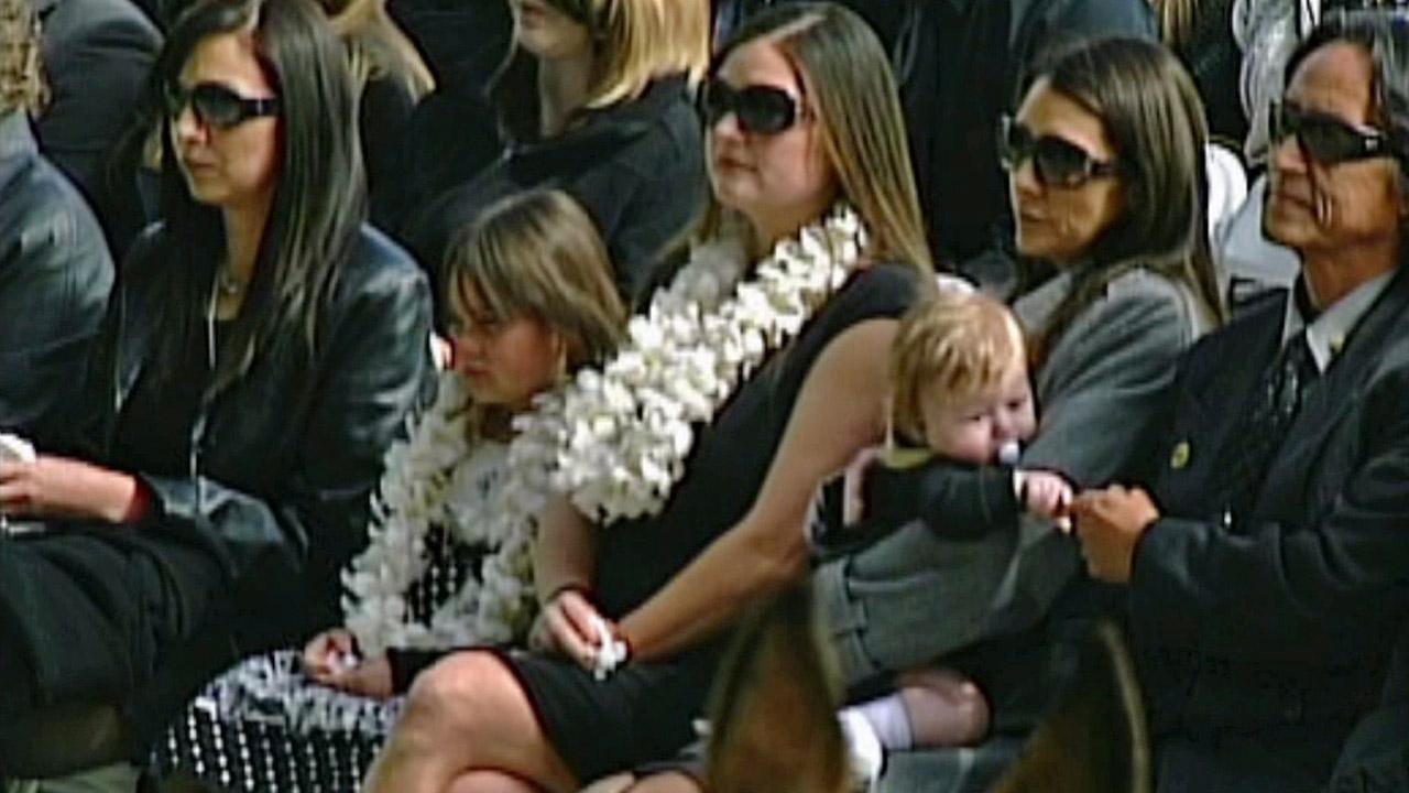 The wife and children of San Bernardino County Sheriffs Detective Jeremiah MacKay are seen at his funeral service on Thursday, Feb. 21, 2013.