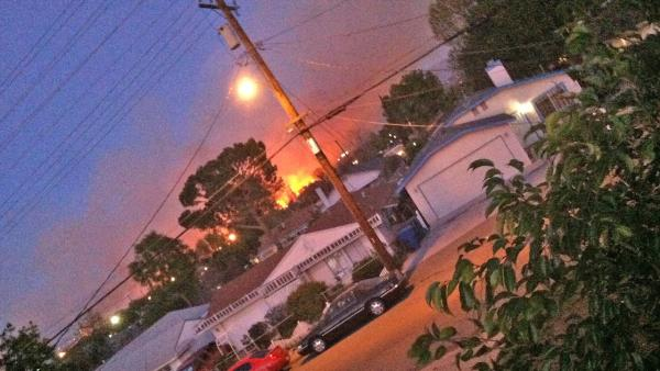 An ABC7 viewer sent us this photo of a brush fire burning near homes in J