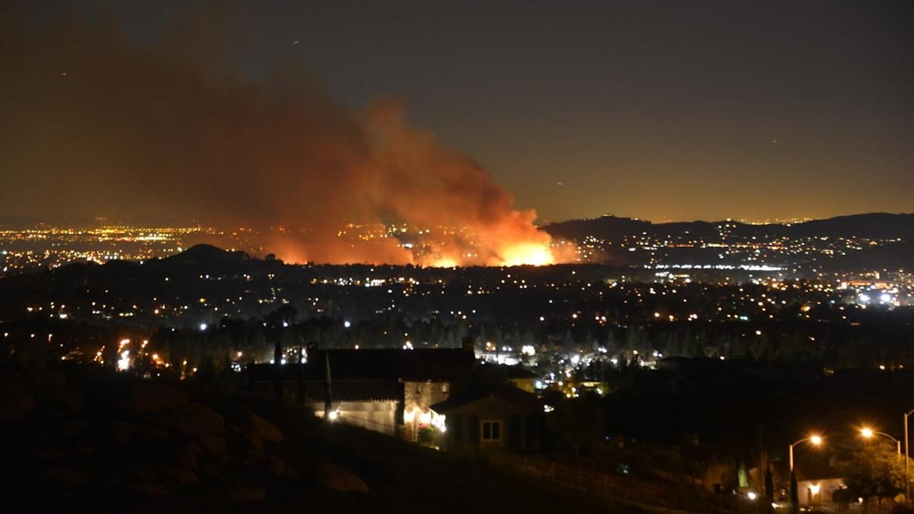 ABC7 viewer sent us this photo of a brush fire burning near homes in Jurupa Valley on Thursday, Feb. 28, 2013. <span class=meta>(ABC7 viewer Tom Jones)</span>