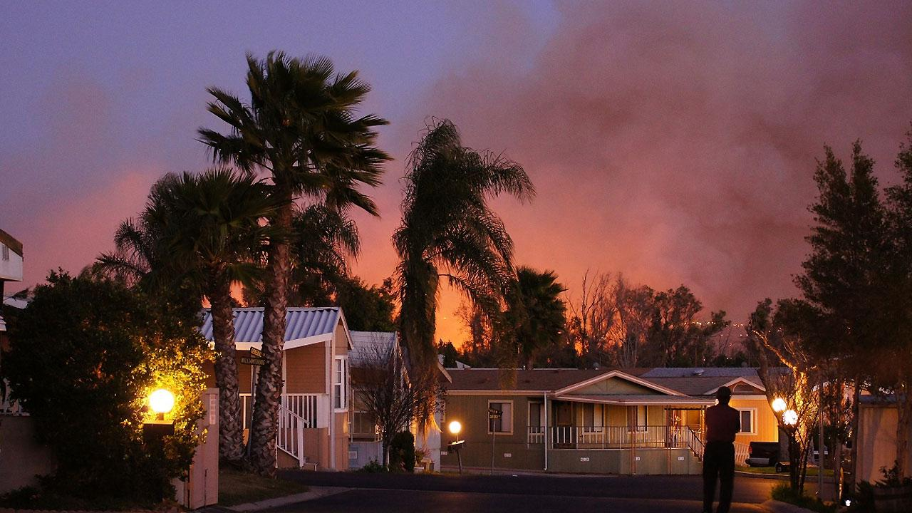 ABC7 viewer Scott Hall sent us this photo of a brush fire burning near homes in Jurupa Valley on Thursday, Feb. 28, 2013. <span class=meta>(ABC7 viewer Scott Hall)</span>