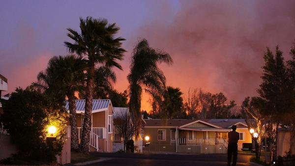 ABC7 viewer Scott Hall sent us this photo of a brush fire burning near homes in Jurupa Valley on Thursday, Feb. 28, 2013.