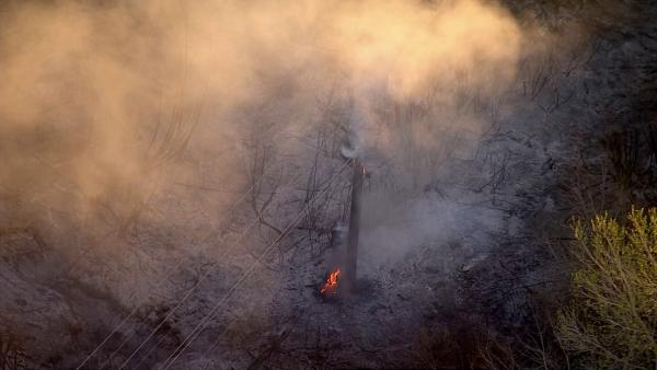A brush fire is seen in a riverbed in Jurupa Valley on Friday, March 1, 2013.