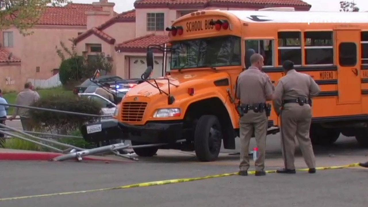 An investigation is under way after a bus rolled backwards, striking and pinning a 5-year-old girl under its wheels outside Box Springs Elementary located on the 11900 block of Athens Drive on Monday, March 18, 2013.