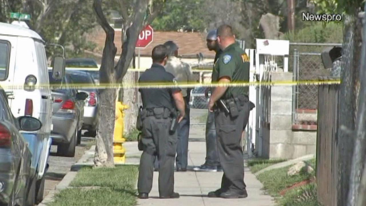 Law enforcement officials are shown at the scene of a fatal shooting on the 700 block of 11th Street in San Bernardino on Saturday, April 27, 2013.