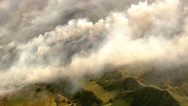 A brush fire broke out in Banning, burning through thousands