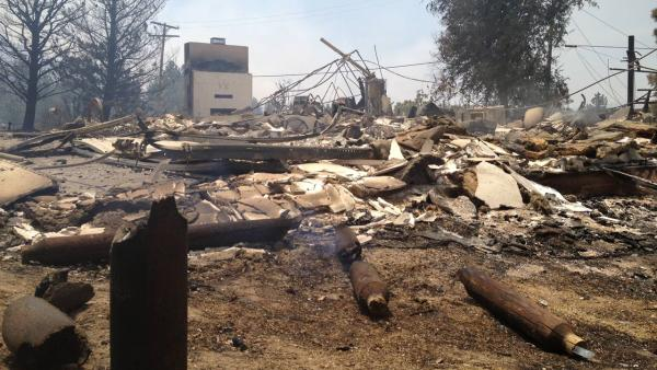 Ruins of a home are seen after the Mountain Fire near Idyllwild tore through Tuesday, July 16, 2013.