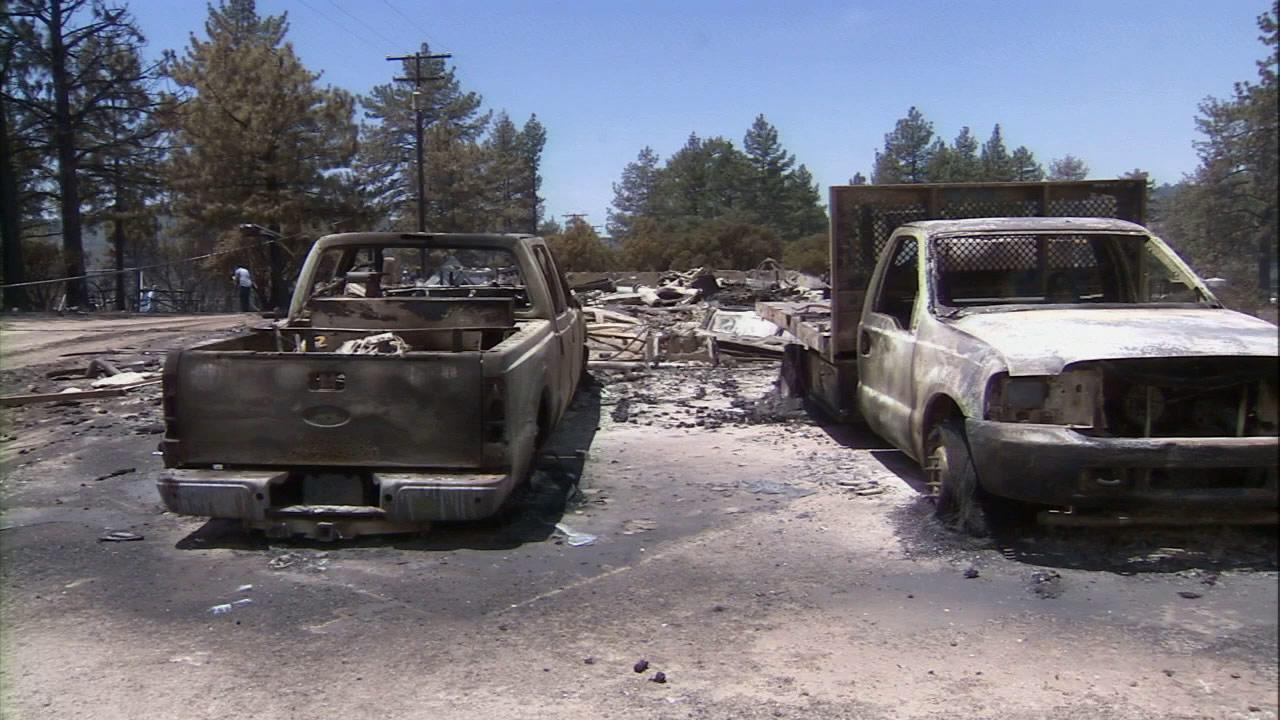 Charred trucks are seen after the Mountain Fire near Idyllwild tore through on Wednesday, July 17, 2013.