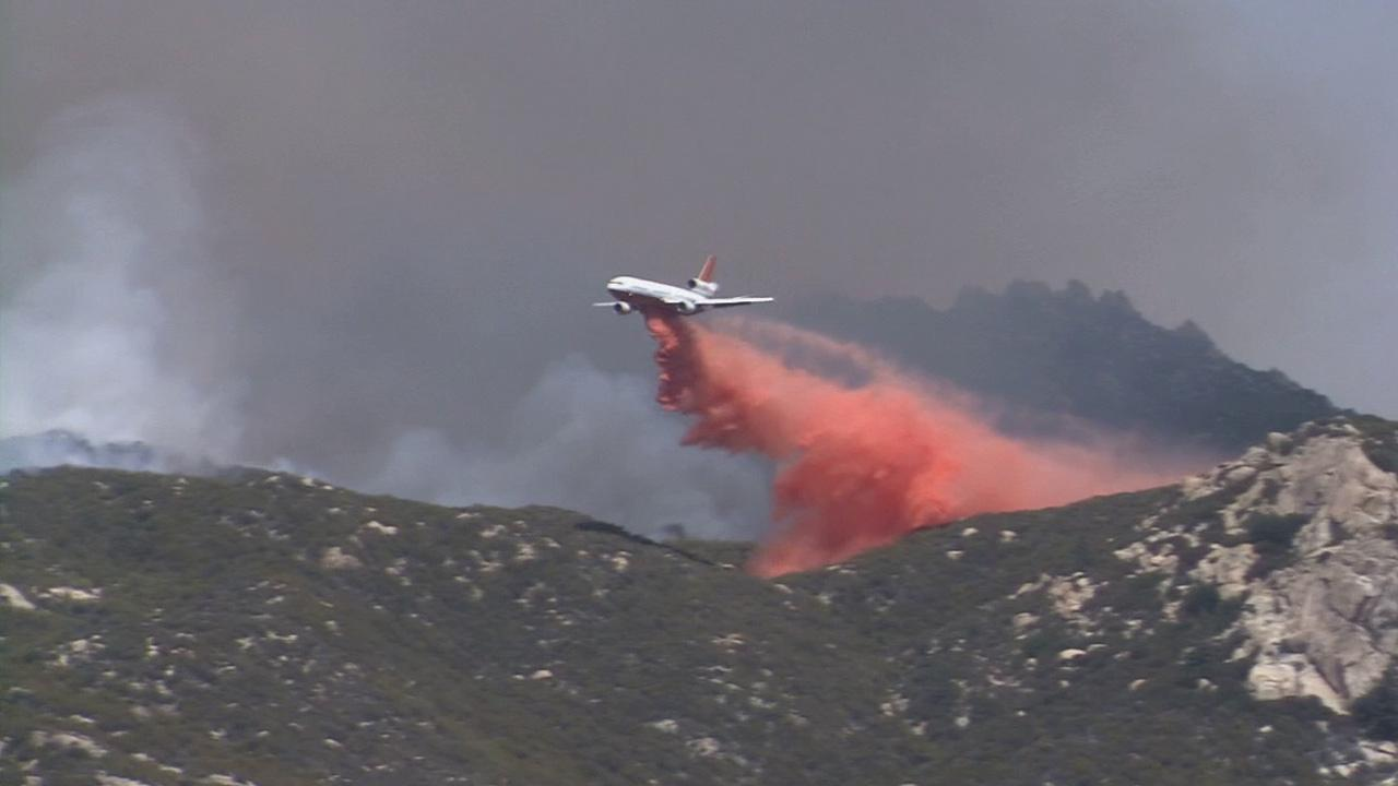 Crews fight the Mountain Fire in Riverside County from the air on Wednesday, July 17, 2013.