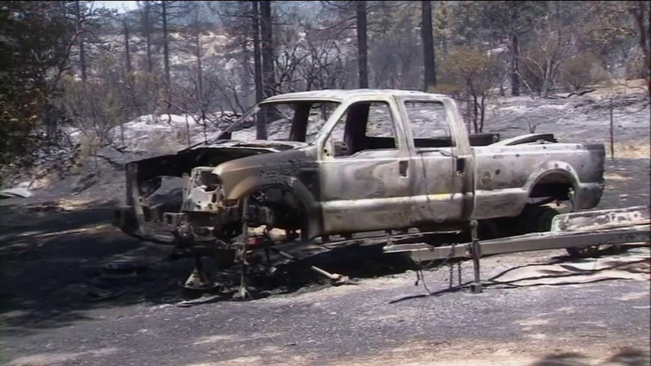 A charred truck is seen after the Mountain Fire near Idyllwild tore through on Wednesday, July 17, 2013.