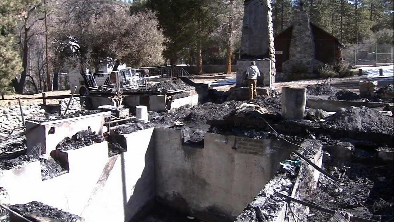 A Big Bear-area cabin where fugitive Chris Dorner is believed to have died on Wednesday, Feb. 13, 2013, is seen after the structure went up in flames.