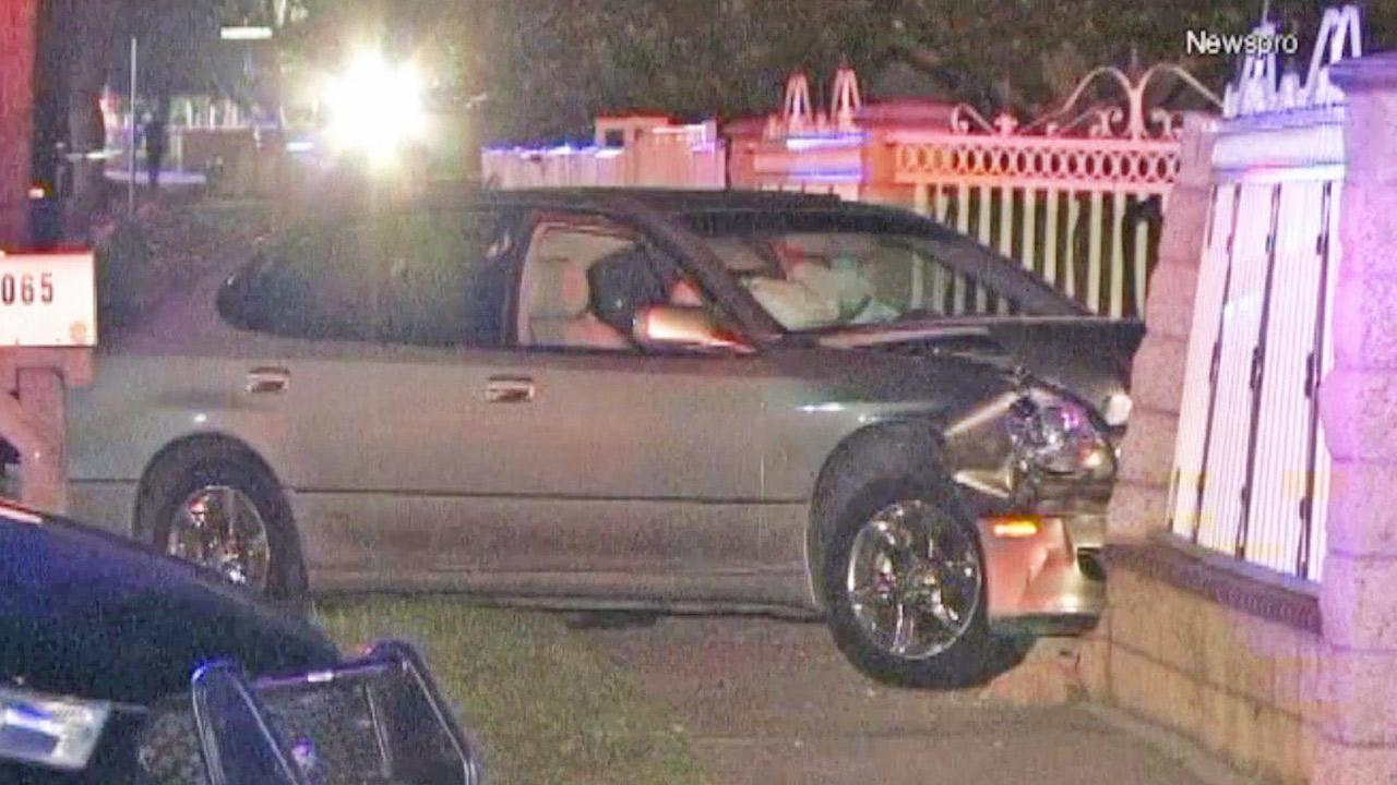 A man in a car, seen crashed into a fence in the 1000 block of North Willow Avenue in Rialto, was shot and killed on Friday, Nov. 8, 2013.