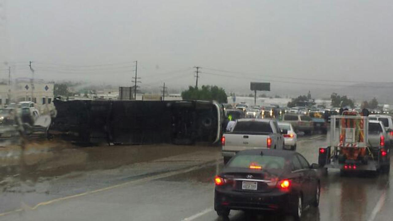 A tour bus overturned on the northbound 15 Freeway at Magnolia Avenue in Corona on Thursday, Dec. 19, 2013. <span class=meta>(ABC7 viewer Peter Marquez)</span>