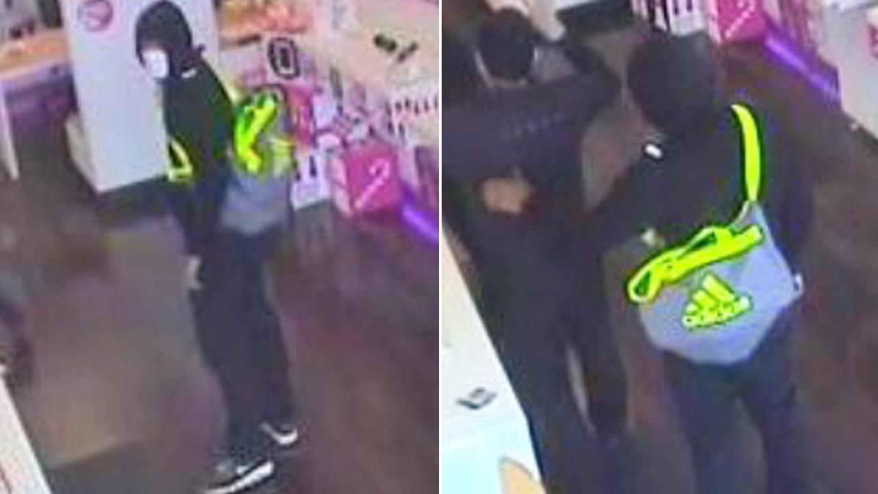 Surveillance still images show a suspect wanted for robbing a T-Mobile store in Upland on Friday, Dec. 27, 2013.