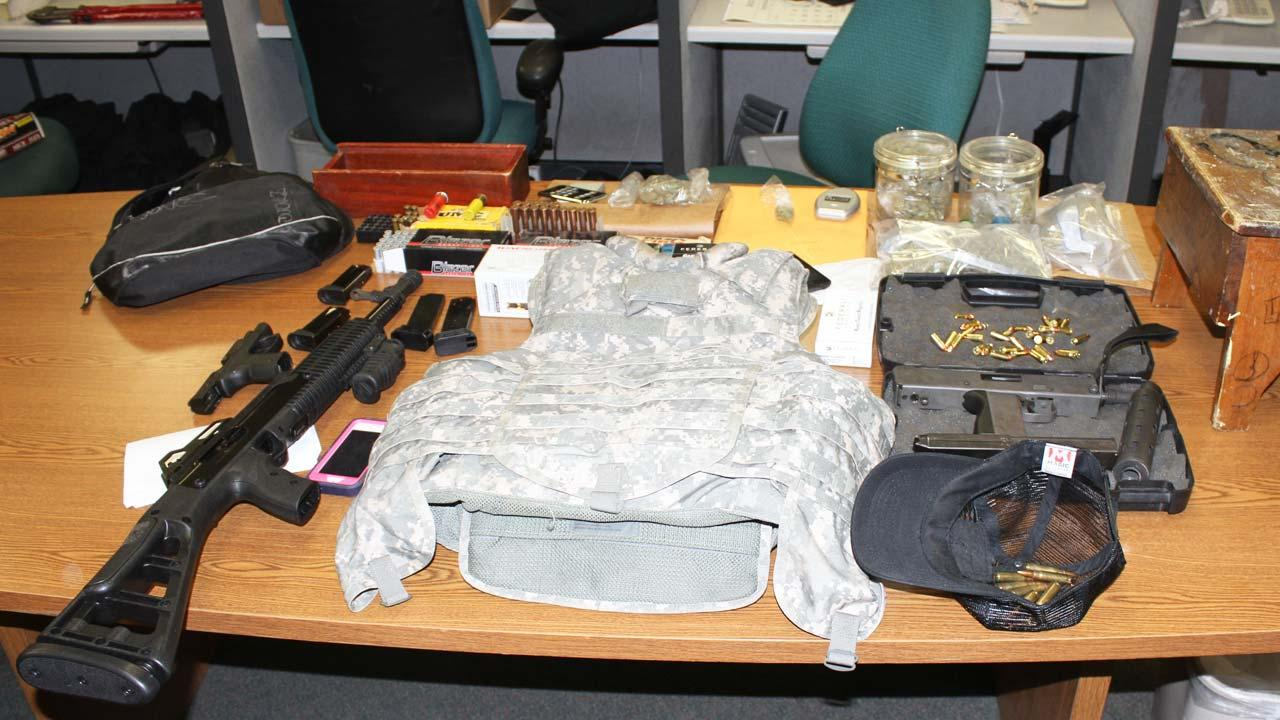 A MAC-11 submachine gun with extended magazine, a .40-caliber carbine rifle and a 9-mm pistol were seized in searches in San Bernardino Wednesday morning, January 29, 2014, along with a flak jacket and a pound of marijuana.