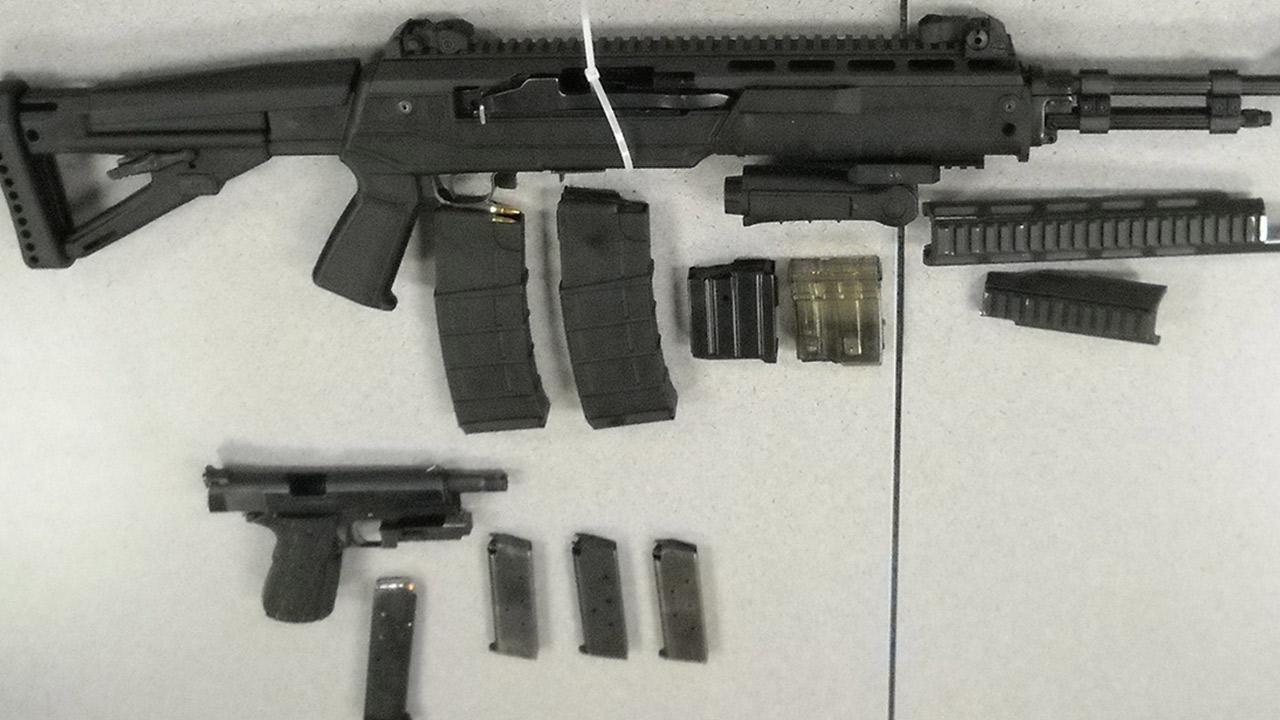 The San Bernardino County Sheriffs Department released this photo of weapons recovered during an investigation into a deputy being shot at by a suspect in Victorville on Sunday, Feb. 2, 2014.