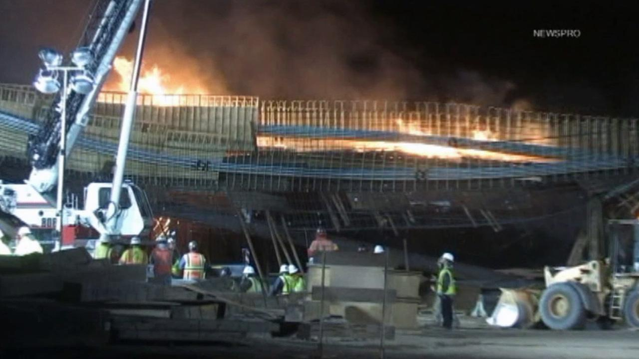 Crews work overnight to put out the fire on the Ranchero Road Bridge on the I-15 in Hesperia. <span class=meta>(NEWSPRO)</span>