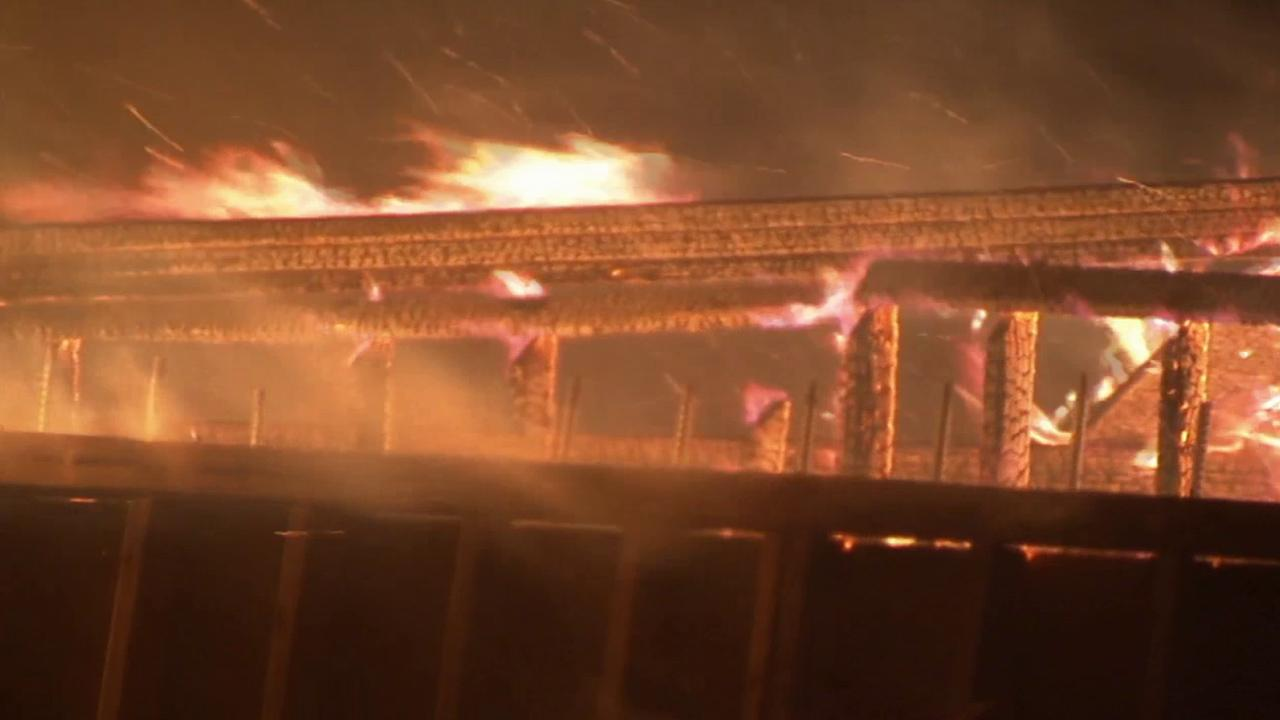 Flames burn wildly on the Ranchero Road Bridge in Hesperia on Monday, May 5, 2014.