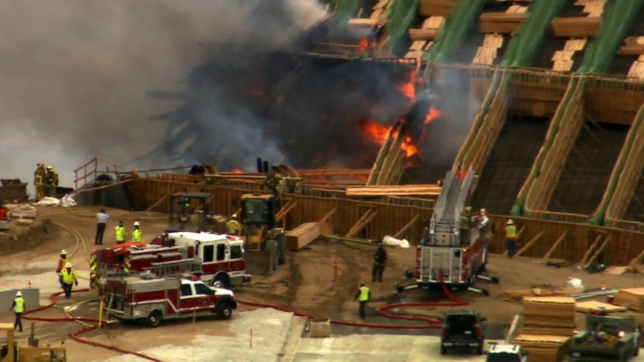 Firefighters work to put out the flames on the Ranchero Road Bridge in Hesperia on Monday, May 5, 2014.