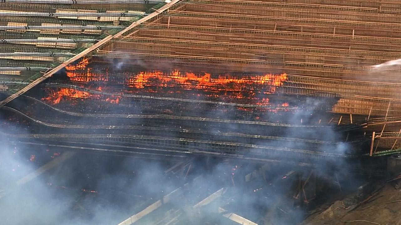 Smoke and flames are seen in this aerial view of the Ranchero Road Bridge fire in Hesperia on Monday, May 5, 2014.