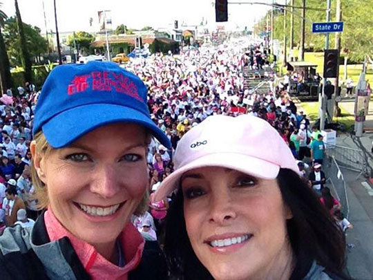 ABC7 anchors Michelle Tuzee and Ellen Leyva are seen at the Revlon Run/Walk in Exposition Park on Saturday, May 10, 2014.