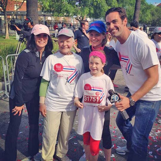 ABC7's Ellen Leyva and Elex Michaleson are seen with Michelle Tuzee, her daughter, and mother at the Revlon/Run Walk at Exposition Park on Saturday, May 10, 2014.