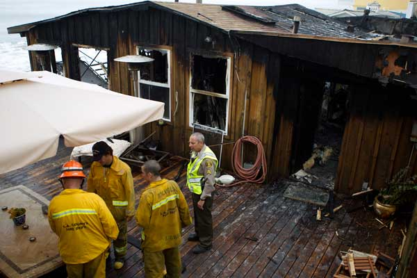"<div class=""meta image-caption""><div class=""origin-logo origin-image ""><span></span></div><span class=""caption-text"">Ricki Lake's Malibu home caught fire, forcing her, her two sons and their dog to evacuate Saturday, Sept. 18, 2010. (Samuel Womack)</span></div>"