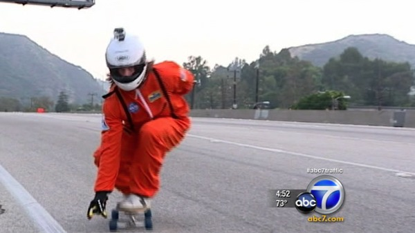 Skateboarder rides down closed 405 Freeway
