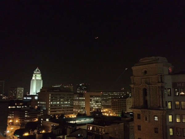 A police helicopter flies over the Occupy Los Angeles encampment at City Hall on Wednesday, Nov. 30, 2011.
