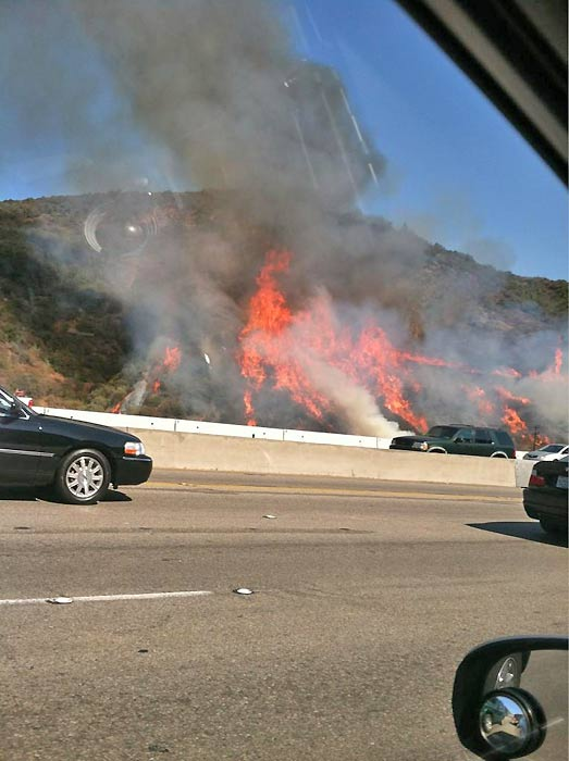 ABC7 viewer Celso Olivera sent us this picture via Twitter of the fire as he drove by on the 405 Freeway. He said he could feel &#34;intense heat&#34; as he passed by. <span class=meta>(Celso Olivera)</span>