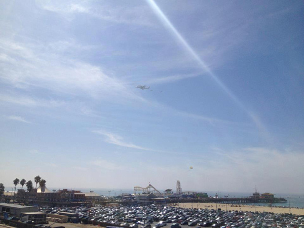 ABC7 viewer Wendy O'Dea took this photo of space shuttle Endeavour flying over the Santa Monica Pier on Friday, Sept. 21, 2012.