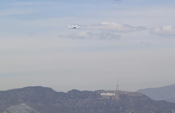 ABC7 viewer Melody Shabtaie took this photo of space shuttle Endeavour over the Hollywood Hills on Friday, Sept. 21, 2012. &#160;Send us your shuttle pictures and video to video@abc7.com or post them to the ABC7 Facebook page. You can also Tweet us @abc7 with #SpotTheShuttle. <span class=meta>(ABC7 viewer Melody Shabtaie)</span>