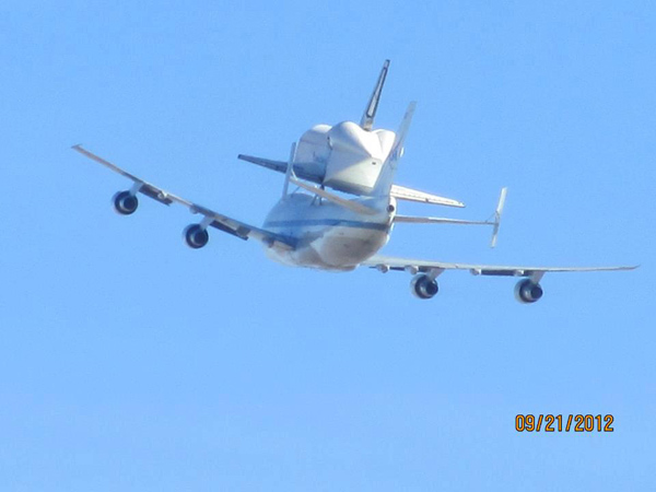 ABC7 viewer Debra Mitchell-Adams took this photo of space shuttle Endeavour flying over her house in Quartz Hill on Friday, Sept. 21, 2012. &#160;Send us your shuttle pictures and video to video@abc7.com or post them to the ABC7 Facebook page. You can also Tweet us @abc7 with #SpotTheShuttle. <span class=meta>(ABC7 viewer Debra Mitchell-Adams)</span>